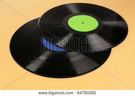Old vinyl records on brown background