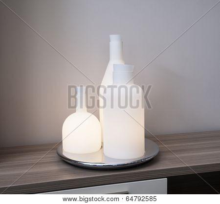 Ornate Bottle Light On Shelf