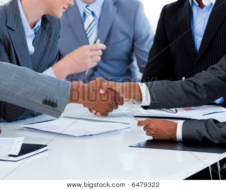 Close-up Of Business People Greeting Each Other
