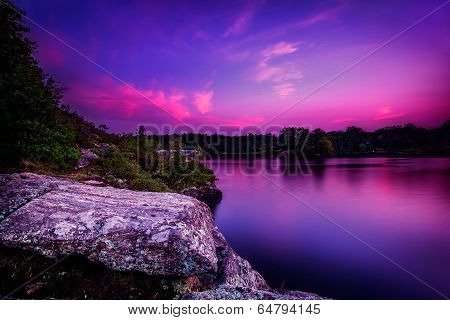 Violet Sunset Over A Calm Lake