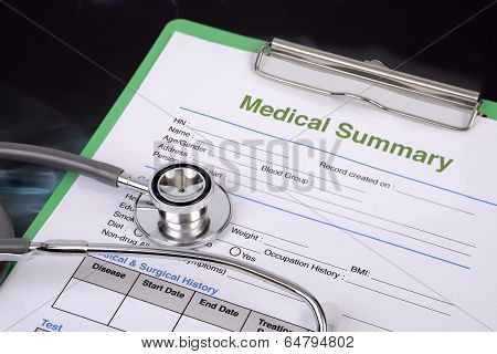 Stethoscope And Blank Medical Record.