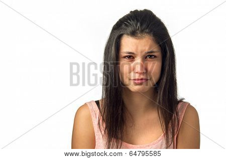 Brunette teenager girl crying with sadness expression