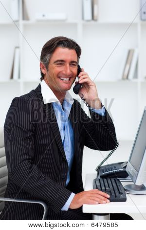 Attractive Businessman Making A Phone Call