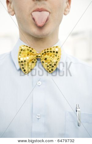 Man Wearing Bow Tie And Sticking Out Tongue