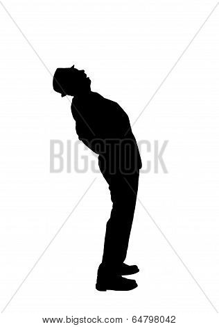 Silhouette of a Man Bending Over Backward to Look Up