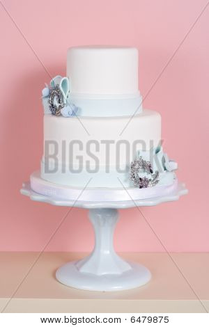 Two-tiered Cake Against Pink Background