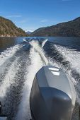 stock photo of outboard engine  - Trace motor boats on the water of a mountain lake - JPG