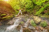 image of virabhadrasana  - Relaxation joga in forest at the Waterfall - JPG