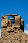 foto of pueblo  - Old belltower from San Geronimo Chapel in Taos Pueblo USA - JPG