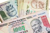 stock photo of indian currency  - Piles of large bills in Indian currency - JPG