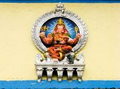 foto of ganesh  - A painted sculpture of the Hindu god Ganesh on the wall of a temple - JPG