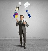 picture of juggler  - Juggler businessman playing with a business object - JPG