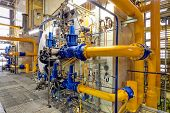 stock photo of petroleum  - Chemical industry plant with pipes and valves - JPG