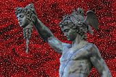 stock photo of medusa  - detail of statue of Perseus holding the head of Medusa on white background Florence Italy - JPG