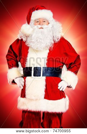 Image of Santa Claus in red costume against red background