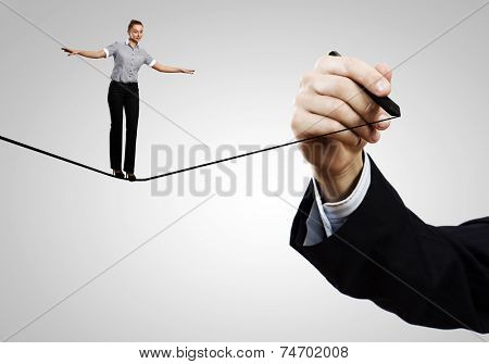 Young confident businesswoman standing on drawn line
