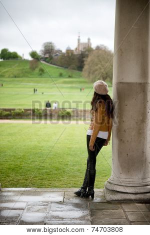 Woman Leaning Against Pillar at National Maritime Museum in Greenwich, London, England