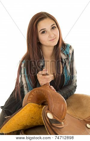 Cowgirl In Plaid Shirt Lead Lean On Saddle