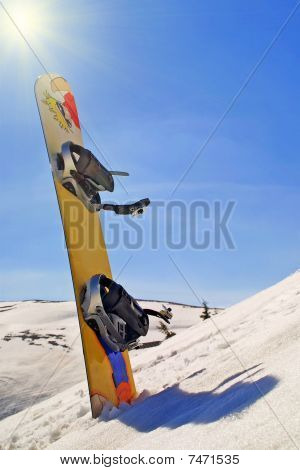 Snowboard In A Snow
