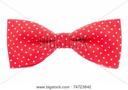 Red Bow Tie With Polka Dots Isolated On White Background