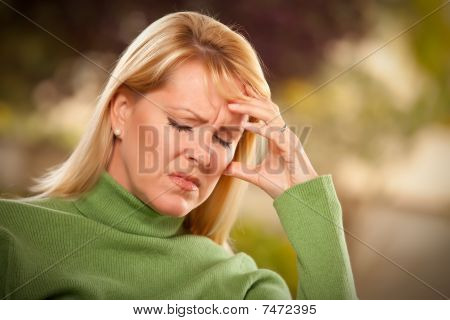 Grimacing Woman Suffering A Headache Or Sorrow