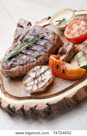Portion Of Bbq T-bone Steak With  Sauce  And Grilled Vegetables