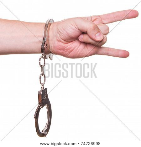 Male Hand In Police Handcuffs Showing Gesture Isolated On White Background