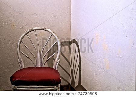 Old Chair In Empty Room