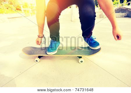 woman skateboarder skateboarding at skate park