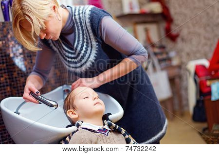 Little Client Having His Hair Washed In A Hairdressing Salon