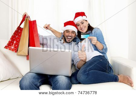 Young Attractive Hispanic Couple In Love Online Christmas Shopping With Computer