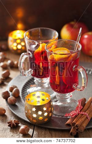 glass of mulled wine with orange and spices, christmas decoration