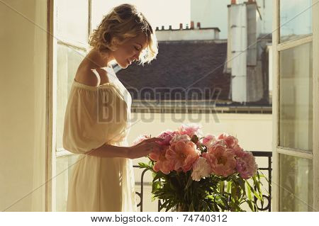 Fashion art portrait of beautiful blonde at the window