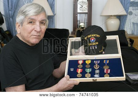 Vietnam Vet Show His Medals Earned During Service