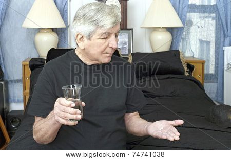 Senior Man Taking Bedtime Medication