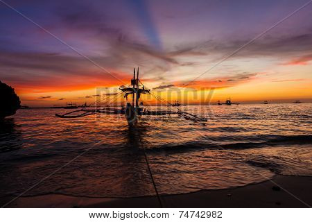 sail boat at sunset sea, boracay island, philippines