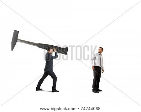 concept photo of conflict between businesspeople. amazed businessman turning around and looking at big hammer. isolated on white background