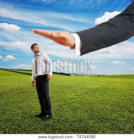 amazed businessman turning around and looking at big palm. photo at outdoor