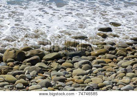 Beach Cobbles And Tide Foam