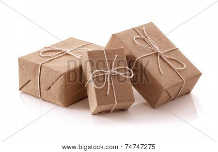Gift packages wrapped in brown recycled paper isolated on white
