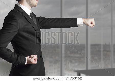 Businessman In Office in Karate punch