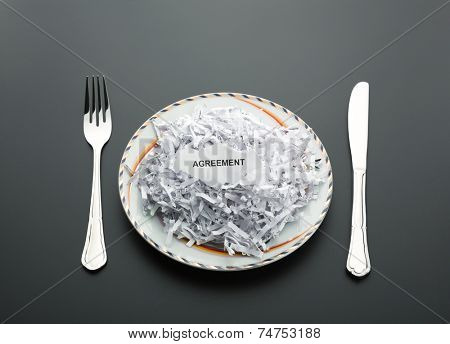 Heap of shredded papers on the plate