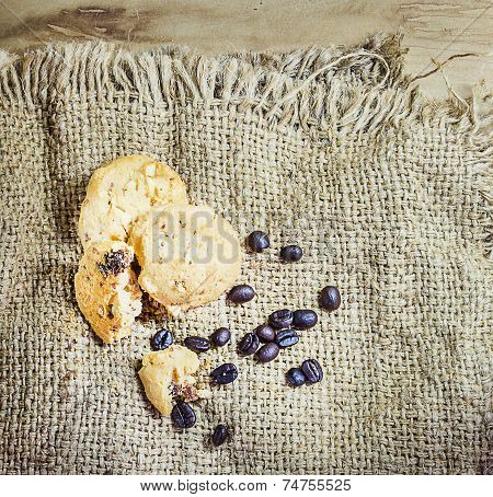 Cookie And Coffee Beens On Sacks Background