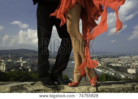 Beautiful legs of a dancer woman and city scape behind