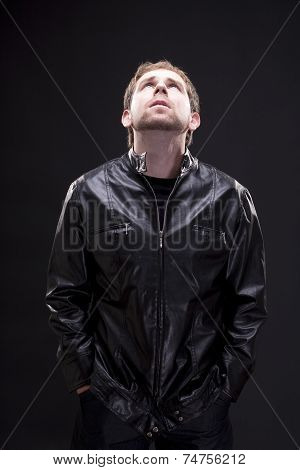 Portrait of a man with leather jacket looking up