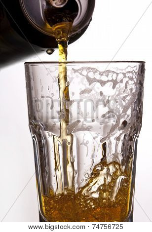 Bottle of beer pouring into a glass