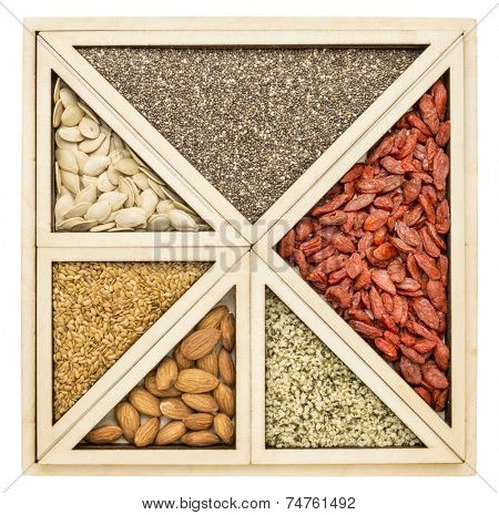 square and triangles - superfood abstract -  chia seeds , dried goji berries, golden flax, pumpkin seeds, almonds and hemp seed hearts