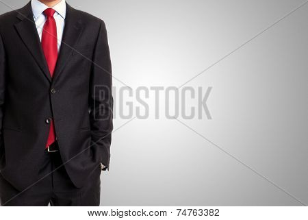 Faceless businessman in front of a grey background