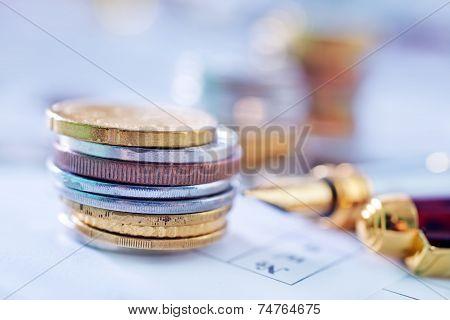 dollars and coins on the table