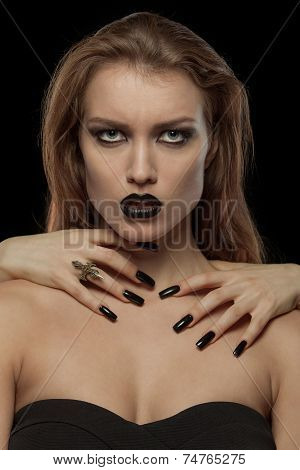 Pretty gothic woman with hands of vampire on her neck